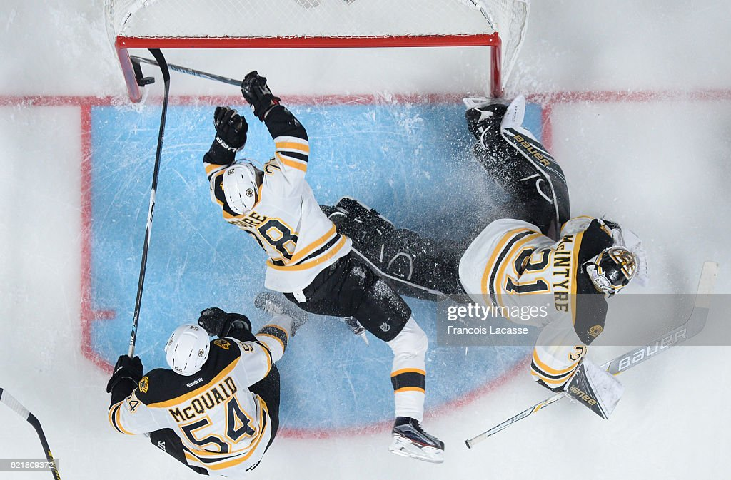 Dominic Moore #28 of the Boston Bruins tries to stop the puck from of the Montreal Canadiens in the NHL game at the Bell Centre on November 8, 2016 in Montreal, Quebec, Canada.