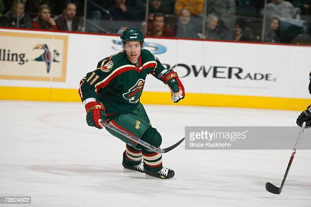 Dominic Moore of the Minnesota Wild skates against the San Jose Sharks during the game at Xcel Energy Center on March 6 2007 in Saint Paul Minnesota...