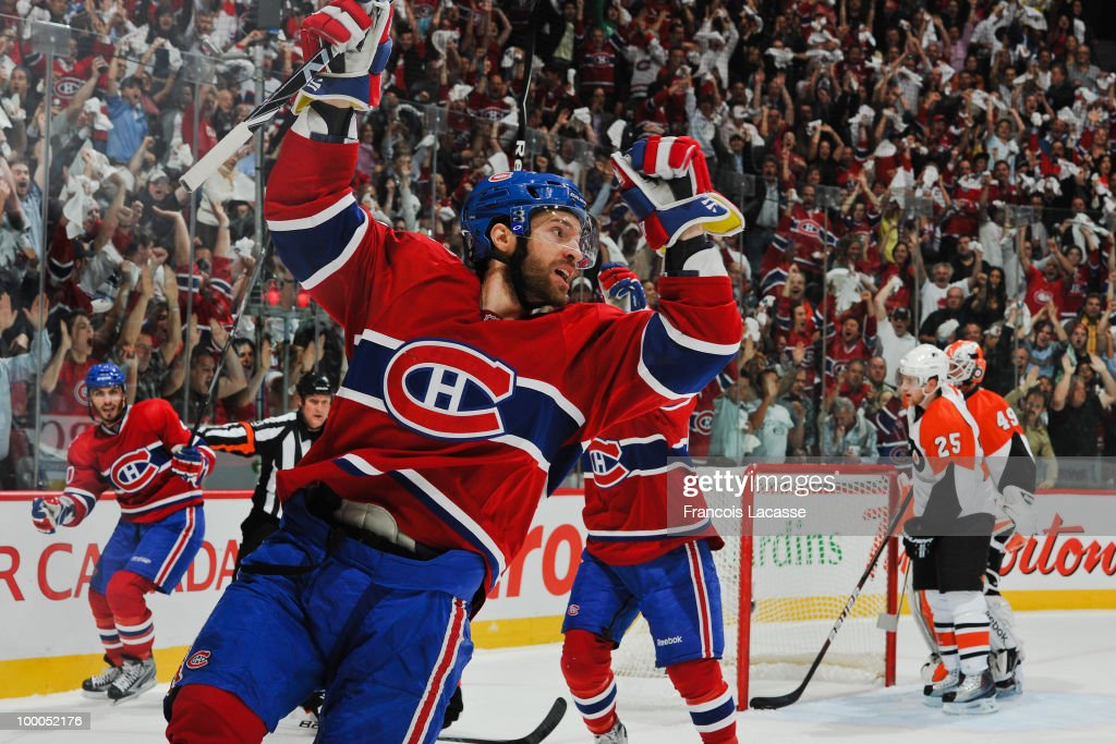Dominic Moore #42 of the Montreal Canadiens celebrates the goal of teammate Tom Pyatt #94 in Game Three of the Eastern Conference Finals against the Philadelphia Flyers during the 2010 NHL Stanley Cup Playoffs at the Bell Centre on May 20, 2010 in Montreal, Quebec, Canada.
