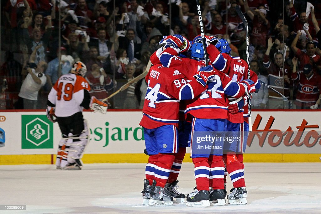Dominic Moore #42 of the Montreal Canadiens celebrates with his team after scoring a goal against Danny Briere #48 of the Philadelphia Flyers second period of Game 3 of the Eastern Conference Finals during the 2010 NHL Stanley Cup Playoffs at Bell Centre on May 20, 2010 in Montreal, Canada.