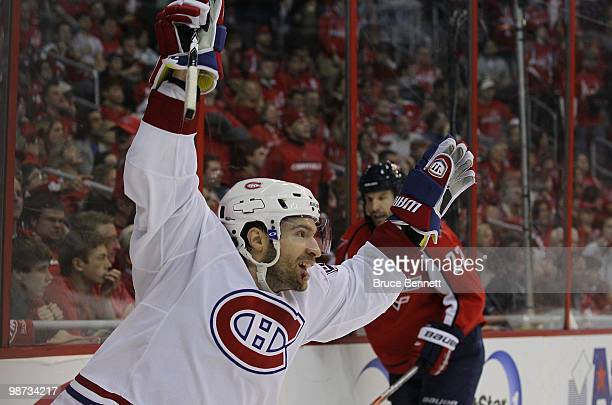 Dominic Moore of the Montreal Canadiens scores the game winning goal in the third period against the Washington Capitals in Game Seven of the Eastern...