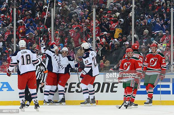 Dominic Moore of the New York Rangers celebrates his goal with Brian Boyle in the first period of the 2014 Coors Light NHL Stadium Series against the...