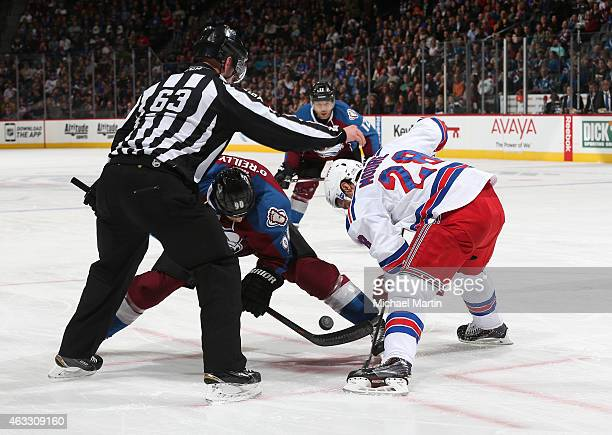 Dominic Moore of the New York Rangers faces off against Ryan O'Reilly of the Colorado Avalanche at the Pepsi Center on February 12 2015 in Denver...