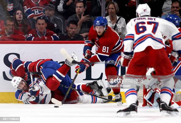 Dominic Moore of the New York Rangers goes after the puck as PK Subban of the Montreal Canadiens checks him into the boards in the first period in...