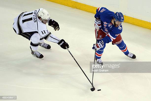 Dominic Moore of the New York Rangers is chased by Anze Kopitar of the Los Angeles Kings in the first period of Game Four of the 2014 Stanley Cup...