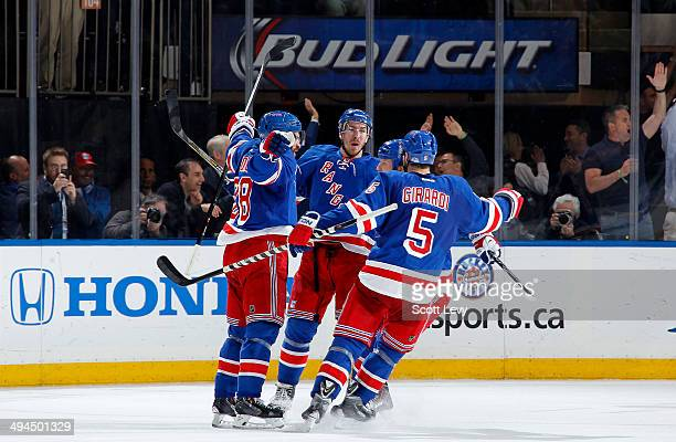 Dominic Moore of the New York Rangers is congratulated after scoring a goal in the second period of Game Six of the Eastern Conference Final against...