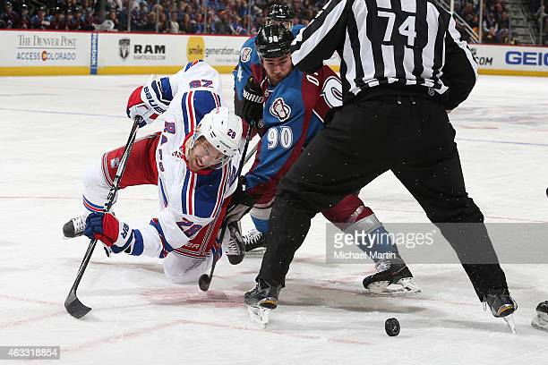 Dominic Moore of the New York Rangers looks to the puck after facing off against Ryan O'Reilly of the Colorado Avalanche at the Pepsi Center on...