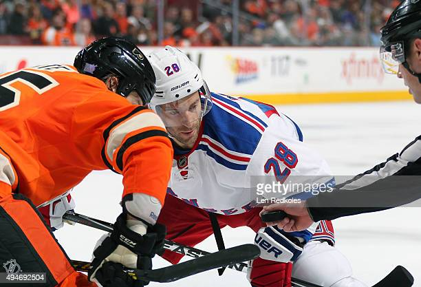 Dominic Moore of the New York Rangers prepares for a faceoff against Ryan White of the Philadelphia Flyers on October 24 2015 at the Wells Fargo...