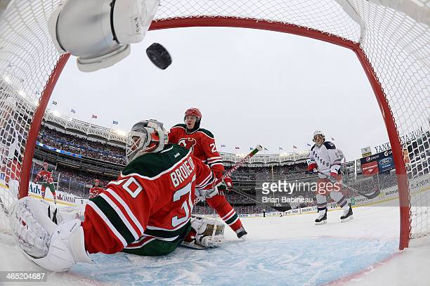 Dominic Moore of the New York Rangers scores a goal against Martin Brodeur of the New Jersey Devils in the first period of the 2014 Coors Light NHL...