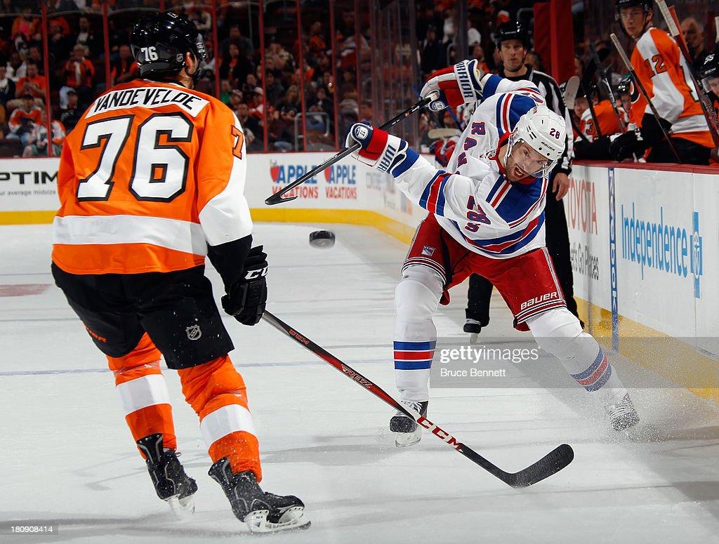 Dominic Moore #28 of the New York Rangers takes the shot past Chris Vande Velde #76 of the Philadelphia Flyers during a preseason game at the Wells Fargo Center on September 17, 2013 in Philadelphia, Pennsylvania.