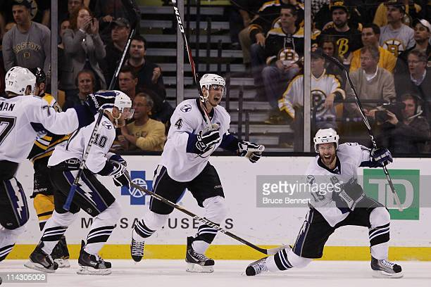 Dominic Moore of the Tampa Bay Lightning celebrates his third period goal against the Boston Bruins with teammates in Game Two of the Eastern...