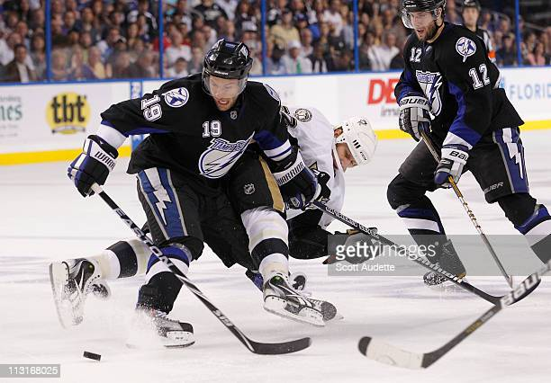 Dominic Moore of the Tampa Bay Lightning keeps Alexei Kovalev of the Pittsburgh Penguins away from the puck during the second period in Game Six of...