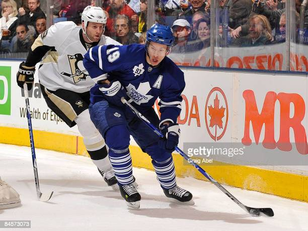 Dominic Moore of the Toronto Maple Leafs battles for the puck with Ryan Whitney of the Pittsburgh Penguins during game action January 31 2009 at the...