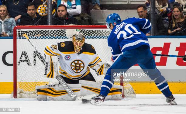 Dominic Moore of the Toronto Maple Leafs goes to the nets against Anton Khudobin of the Boston Bruins during the second period at the Air Canada...