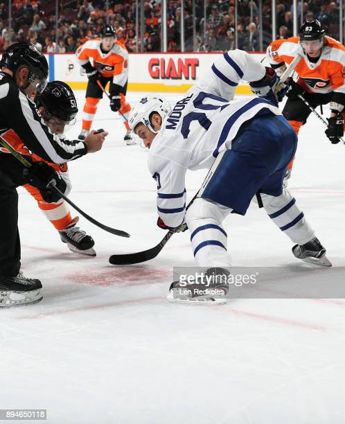 Dominic Moore of the Toronto Maple Leafs keeps his eye on the puck prior to a faceoff against Valtteri Filppula of the Philadelphia Flyers on...
