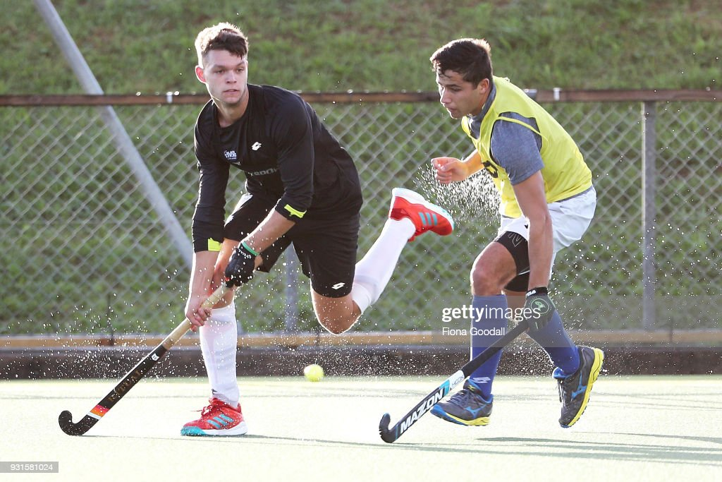 Dominic Newman (L) passes during practise before the New Zealand Commonwealth Games Men's Hockey Team Selection Announcement at Harbour Hockey on March 14, 2018 in Auckland, New Zealand.