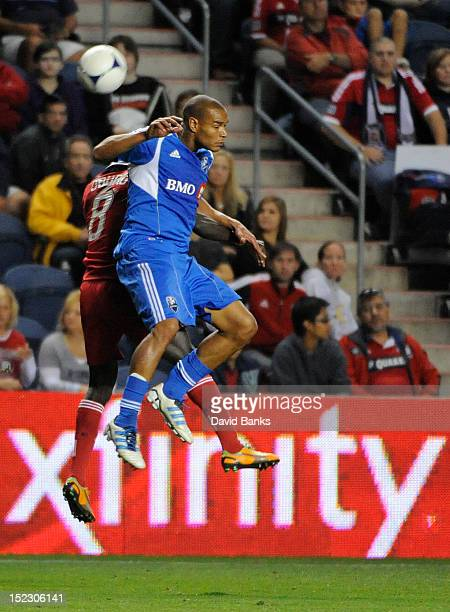 Dominic Oduro of Chicago Fire and Matteo Ferrari of Montreal Impact head the ball in an MLS match on September 15 2012 at Toyota Park in Bridgeview...