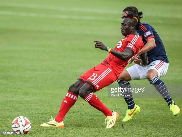 Dominic Oduro of TFC fights for the ball with Daigo Kobayashi of NER during the game between Toronto FC and New England Revolution at BMO Field