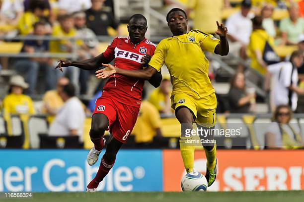 Dominic Oduro of the Chicago Fire and Emmanuel Ekpo of the Columbus Crew race to a loose ball June 12 2011 at Crew Stadium in Columbus Ohio