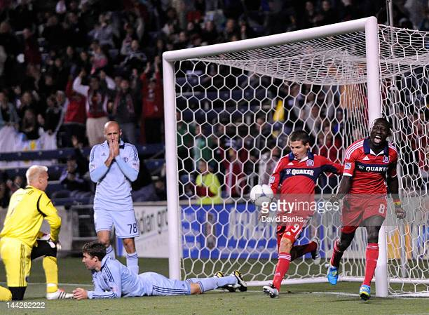 Dominic Oduro of the Chicago Fire and Federico Puppo celebrate Oduro's goal as Jimmy Nielsen Aurelien Collin and Matt Besler of the Sporting Kansas...