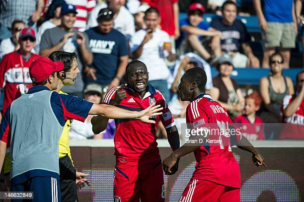 Dominic Oduro of the Chicago Fire and teammate Patrick Nyarko argue with the line judge after a goal was disallowed against the New York Red Bulls at...