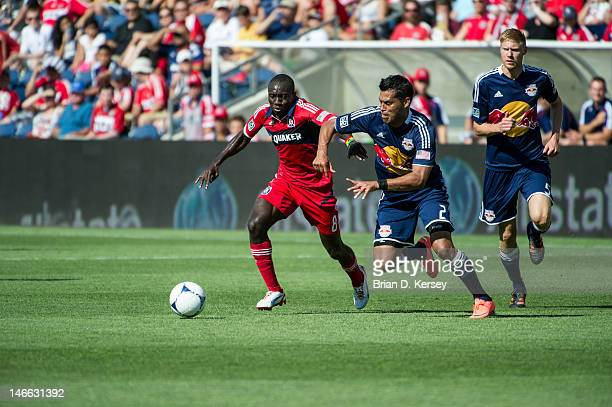 Dominic Oduro of the Chicago Fire and Wilman Conde of the New York Red Bulls go for the ball at Toyota Park on June 17 2012 in Bridgeview Illinois...