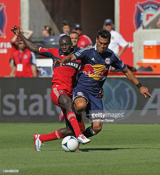 Dominic Oduro of the Chicago Fire battles for the ball wil Wilman Conde of the New York Red Bulls during an MLS match at Toyota Park on June 17 2012...