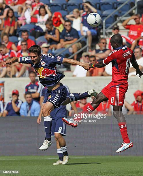 Dominic Oduro of the Chicago Fire beats Heath Pearce of the New York Red Bulls to a header during an MLS match at Toyota Park on June 17 2012 in...
