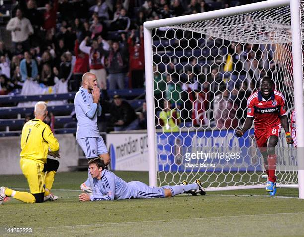 Dominic Oduro of the Chicago Fire celebrates his goal as Jimmy Nielsen Aurelien Collin and Matt Besler of the Sporting Kansas City look on during the...