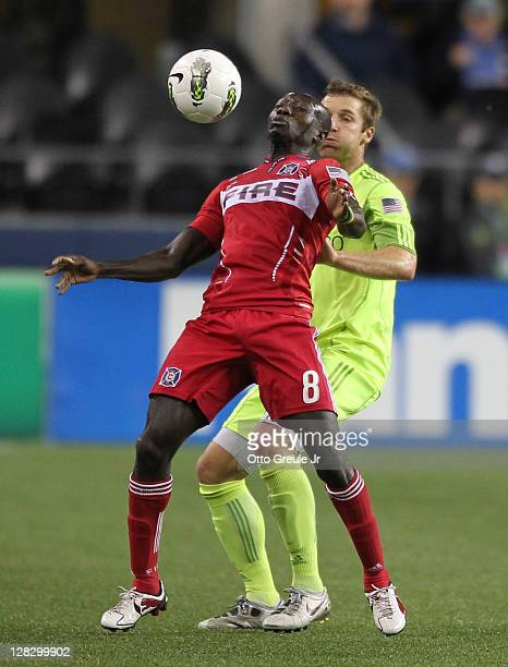 Dominic Oduro of the Chicago Fire controls the ball against Jeff Parke of the Seattle Sounders FC during the 2011 Lamar Hunt US Open Cup Final at...