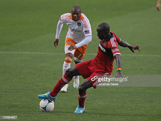 Dominic Oduro of the Chicago Fire controls the ball in front of Luiz Camargo of the Houston Dynamo during an MLS match at Toyota Park on April 15...