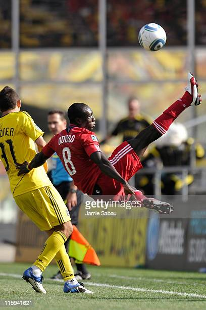 Dominic Oduro of the Chicago Fire kicks the ball back over his head to keep it from going out of bounds against the Columbus Crew on June 12 2011 at...