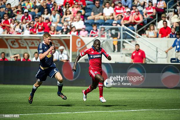 Dominic Oduro of the Chicago Fire moves the ball as Markus Holgersson of the New York Red Bulls defends at Toyota Park on June 17 2012 in Bridgeview...