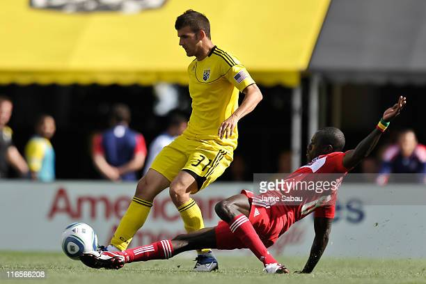 Dominic Oduro of the Chicago Fire slides in to kick the ball away from Josh Gardner of the Columbus Crew on June 12 2011 at Crew Stadium in Columbus...