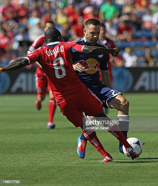 Dominic Oduro of the Chicago Fire tries to kick the ball away from Brandon Barklage of the New York Red Bulls during an MLS match at Toyota Park on...