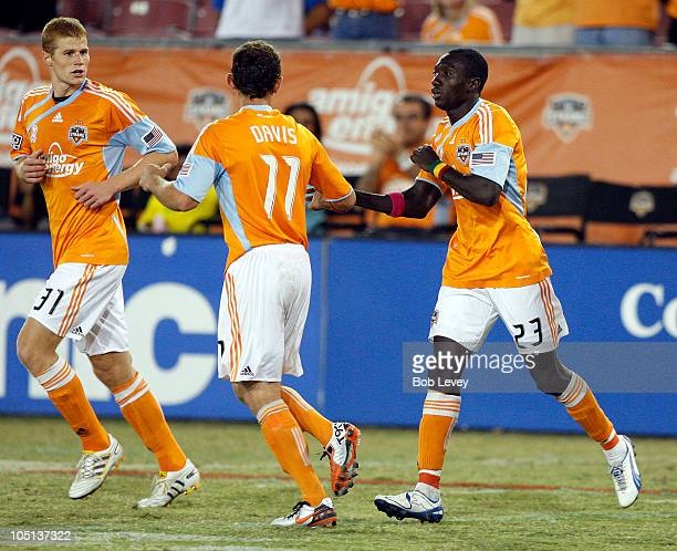Dominic Oduro of the Houston Dynamo celebrates his score with Andrew Hainult and Brad Davis against the New England Revolution at Robertson Stadium...