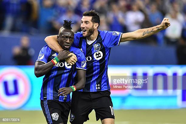 Dominic Oduro of the Montreal Impact celebrates his goal with teammate Ignacio Piatti during leg one of the MLS Eastern Conference finals against the...
