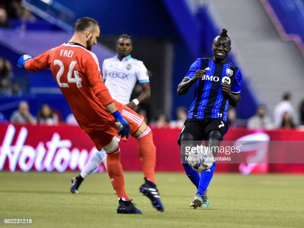 Dominic Oduro of the Montreal Impact runs towards goaltender Stefan Frei of the Seattle Sounders during the MLS game at Olympic Stadium on March 11...