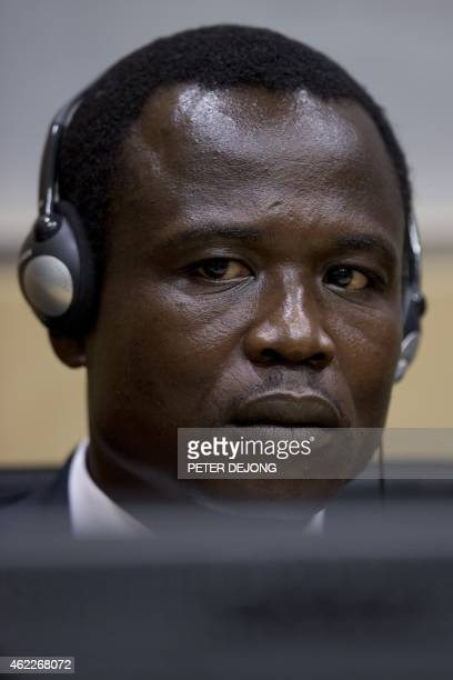 Dominic Ongwen, a Ugandan commander in warlord Joseph Kony's feared militia, waits for the start of court procedures as he made his first appearance...