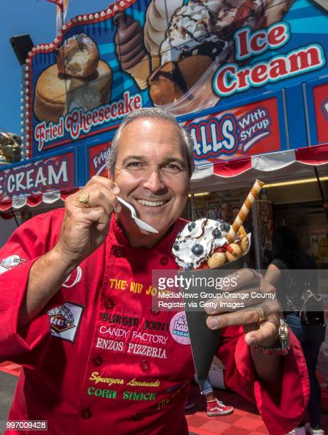 Dominic Palmieri the Midway Gourmet holds the Berry Delight Bubble Waffle Sundae at the San Diego County Fair in Del Mar on Wednesday June 27 2018 It...