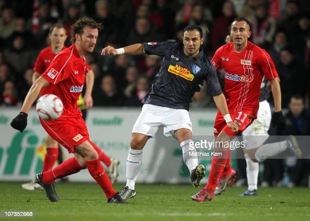 Dominic Peitz Mahir Saglik and Kenan Sahin battle for the ball during the Second Bundesliga match between 1FC Union Berlin and VFL Bochum at Stadion...