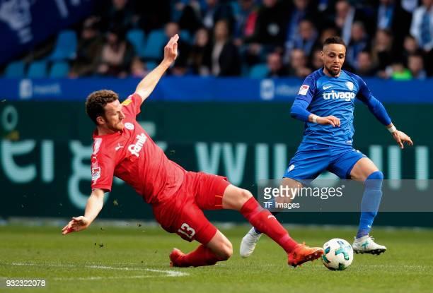 Dominic Peitz of Kiel and Sidney Sam of Bochum battle for the ball during the Second Bundesliga match between VfL Bochum 1848 and Holstein Kiel at...