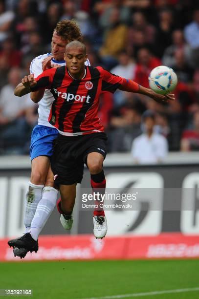 Dominic Peitz of Rostock and Bamba Anderson of Frankfurt jump for a header during the Second Bundesliga match between Eintracht Frankfurt and Hansa...