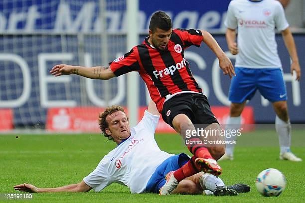 Dominic Peitz of Rostock challenges Uemit Korkmaz of Frankfurt during the Second Bundesliga match between Eintracht Frankfurt and Hansa Rostock at...
