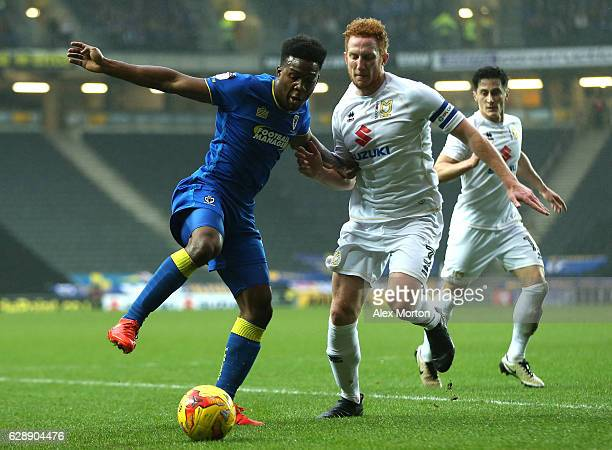 Dominic Poleon of AFC Wimbledon and Dean Lewington of MK Dons battle for possession during the Sky Bet League One match between Milton Keynes Dons...