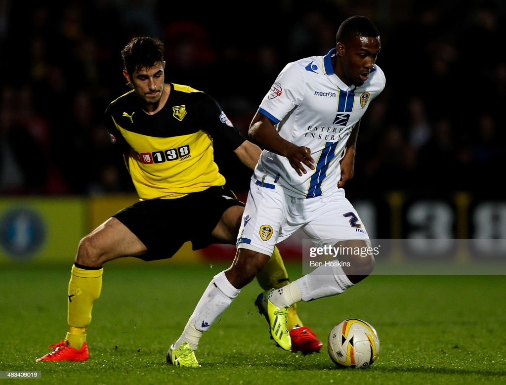 Dominic Poleon (L) of Leeds holds off pressure from Davide Faraoni of Watford during the Sky Bet Championship match between Watford and Leeds United at Vicarage Road on April 8, 2014 in Watford, England.