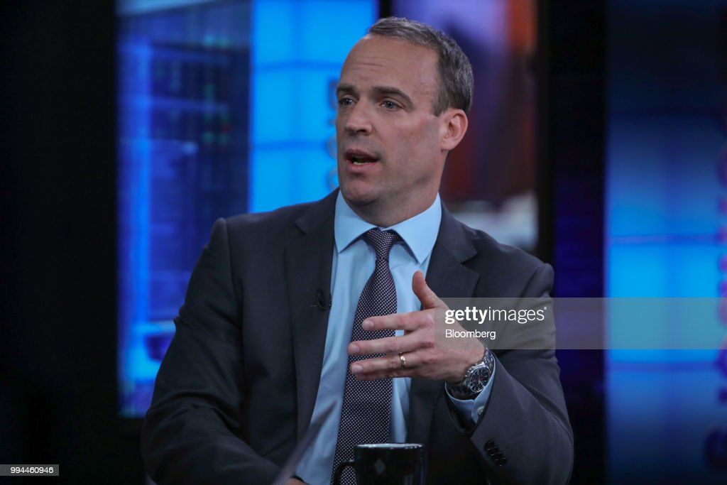 Dominic Raab, Conservative Party candidate for Esher and Walton, gestures while speaking during a Bloomberg Television interview in London, U.K., on Friday, May 19, 2017. U.K. Prime Minister Theresa May was plunged into a crisis after Brexit Secretary David Davis and his deputy resigned over her plans to keep close ties to the European Union after the divorce. The man who is going to inherit one of the toughest jobs in the U.K. -- negotiating Brexit -- is a 44-year-old former Foreign Office lawyer who entered Parliament in 2010: Dominic Raab. Our editors select the best archive images of Raab and Davis. Photographer: Chris Ratcliffe/Bloomberg via Getty Images