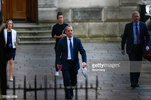 Dominic Raab UK foreign secretary center arrives at Downing Street in London UK on Wednesday April 22 2020 Boris Johnson's coronavirus strategy faces...