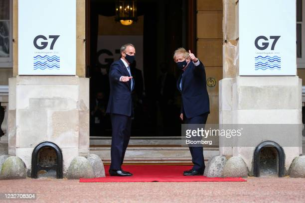 Dominic Raab, U.K. Foreign secretary, left, and Boris Johnson, U.K. Prime minister, gesture ahead of a plenary session on day two of the G-7 foreign...