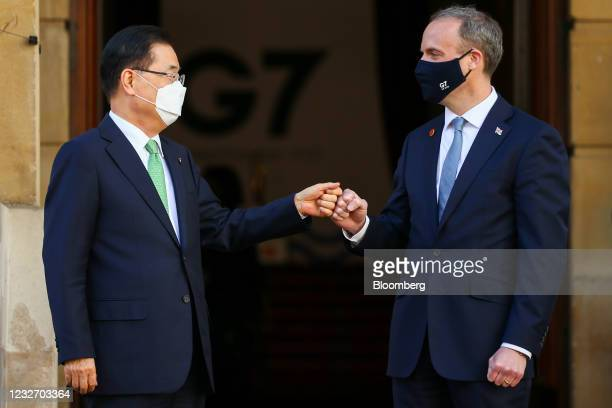 Dominic Raab, U.K. Foreign secretary, right, greets Chung Eui-yong, South Korea's foreign minister, on day two of the G-7 foreign and development...
